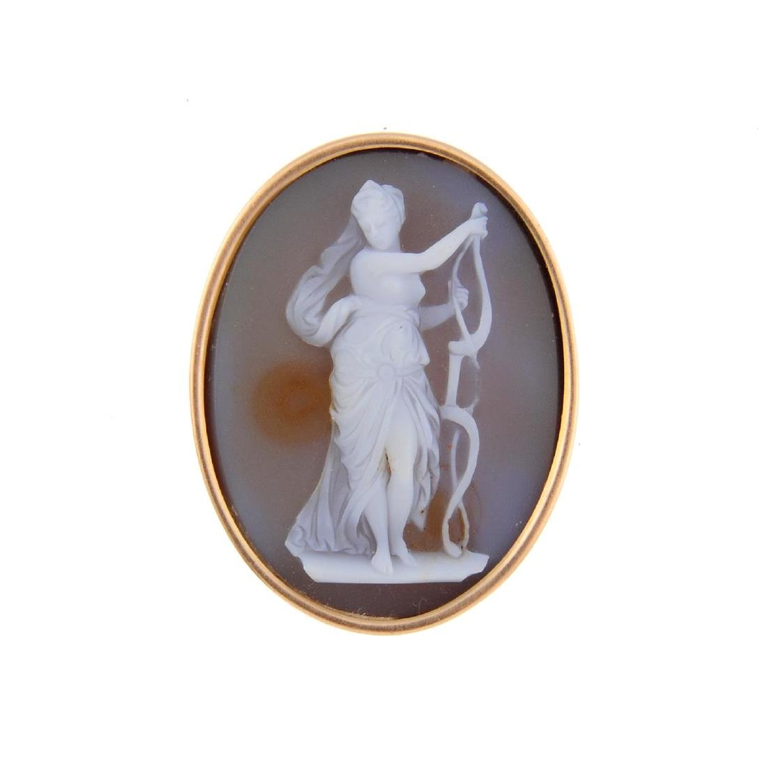 A cameo brooch. The oval agate panel depicting a female