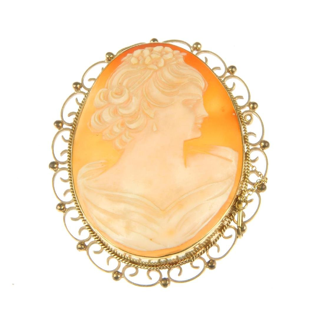 A cameo brooch and a cameo ring. The brooch of
