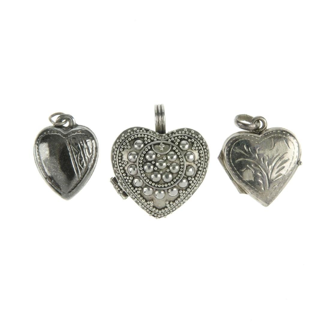 A selection of silver and white metal lockets. To