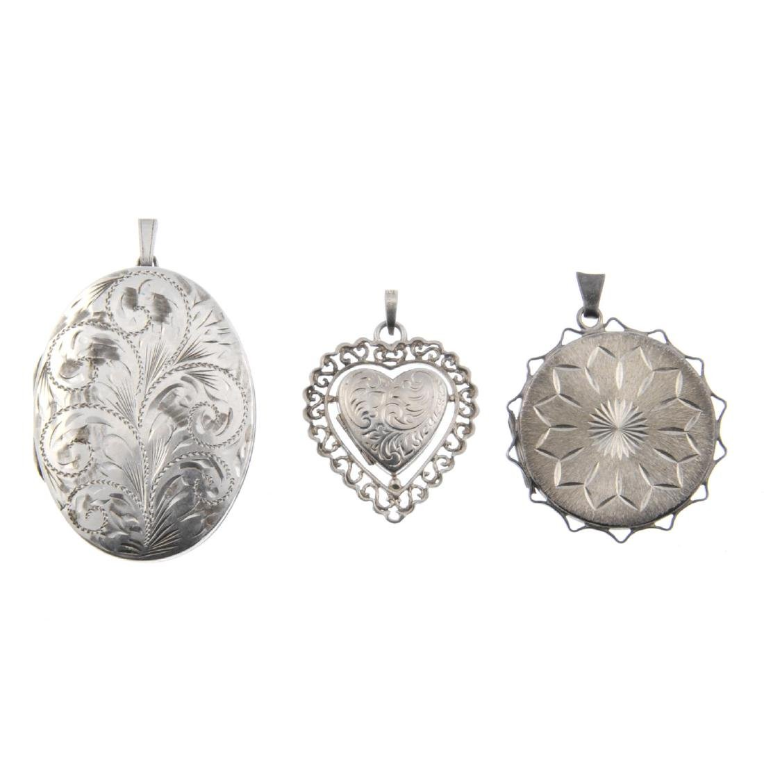 A selection of silver and white metal lockets. Of oval,