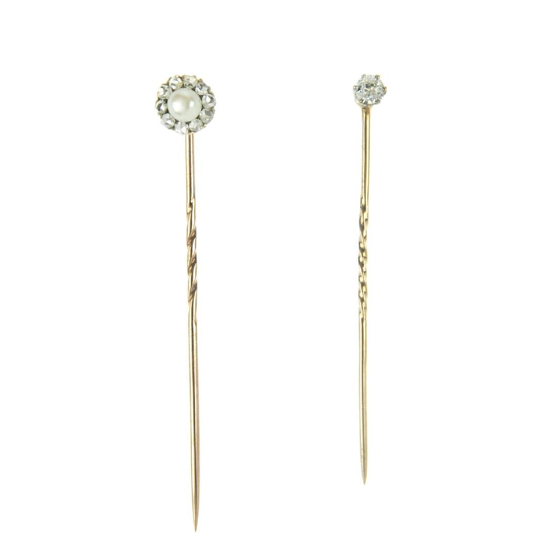 Two diamond-set stickpins. The first a single claw-set