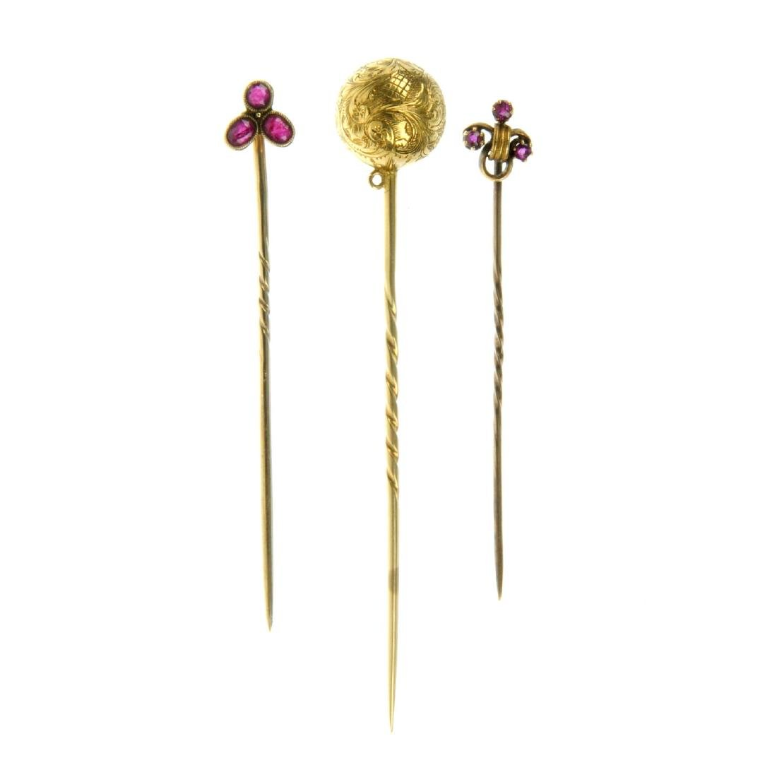 Three late Victorian gold stickpins. To include a