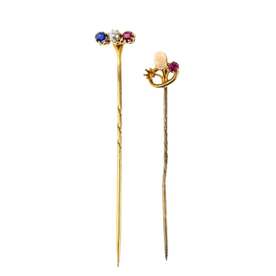 Two gem-set stickpins. The first a row of three stones,