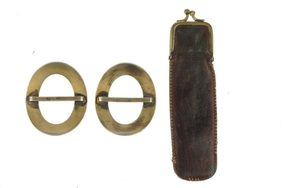 A blackamoor stickpin and two guilloche enamel buckles. - 2