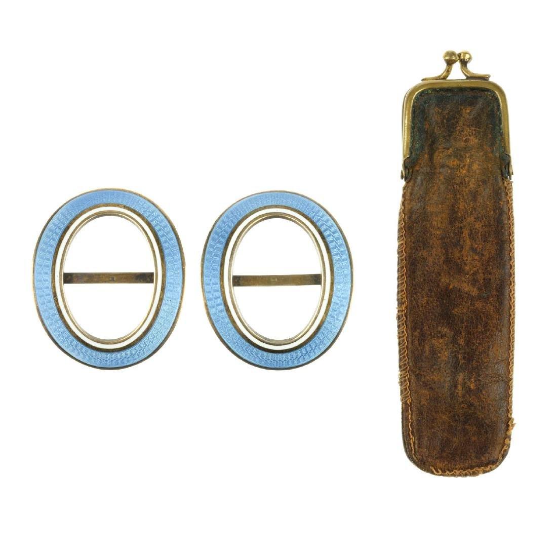 A blackamoor stickpin and two guilloche enamel buckles. - 3