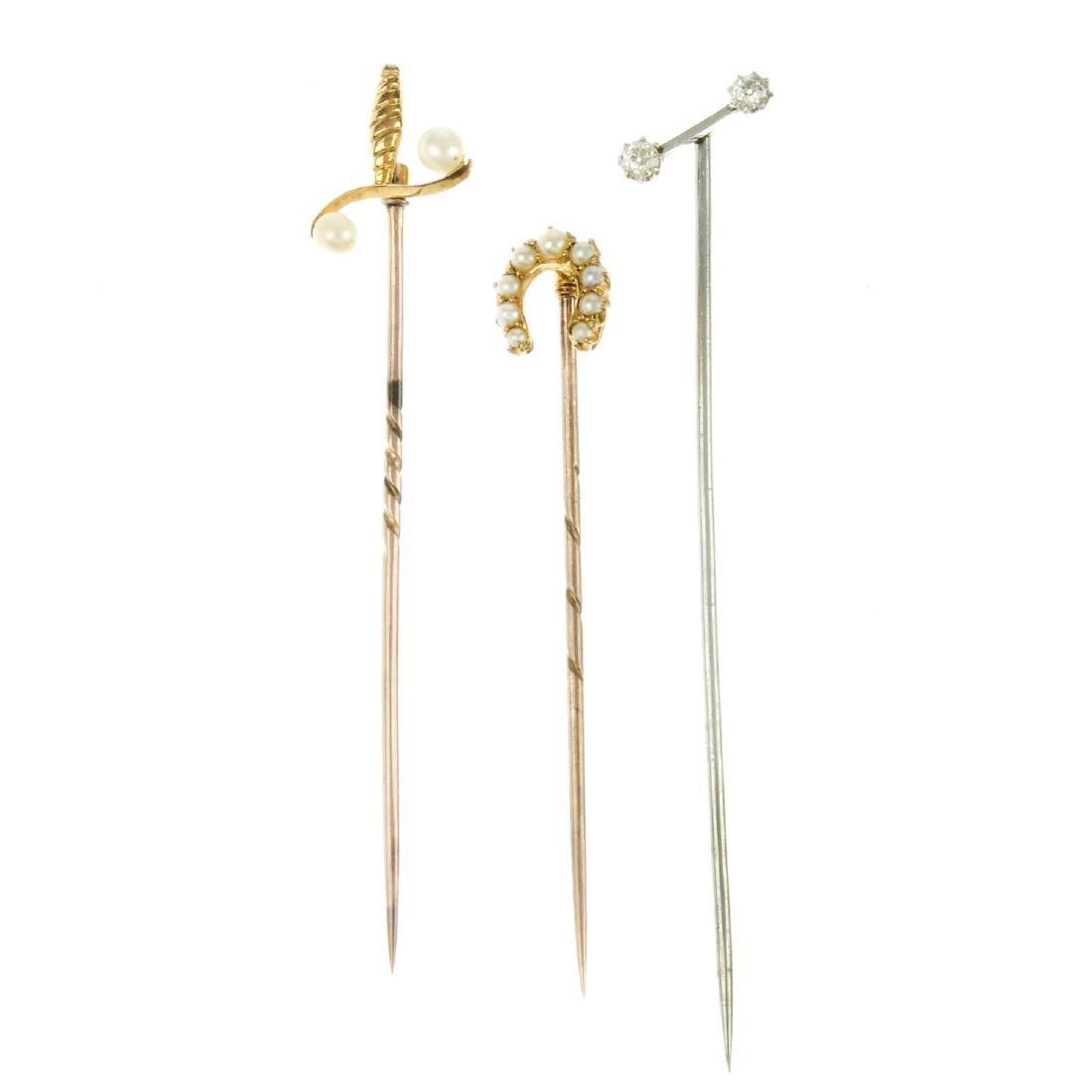 Three gem-set stickpins. The first a diagonal bar with