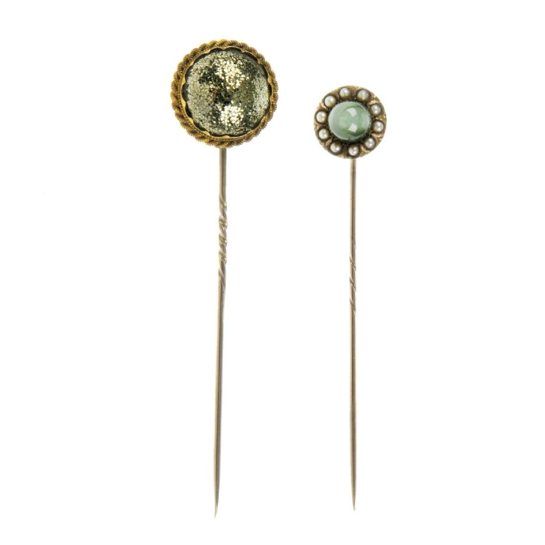 Two late Victorian gem stickpins. The first set with a