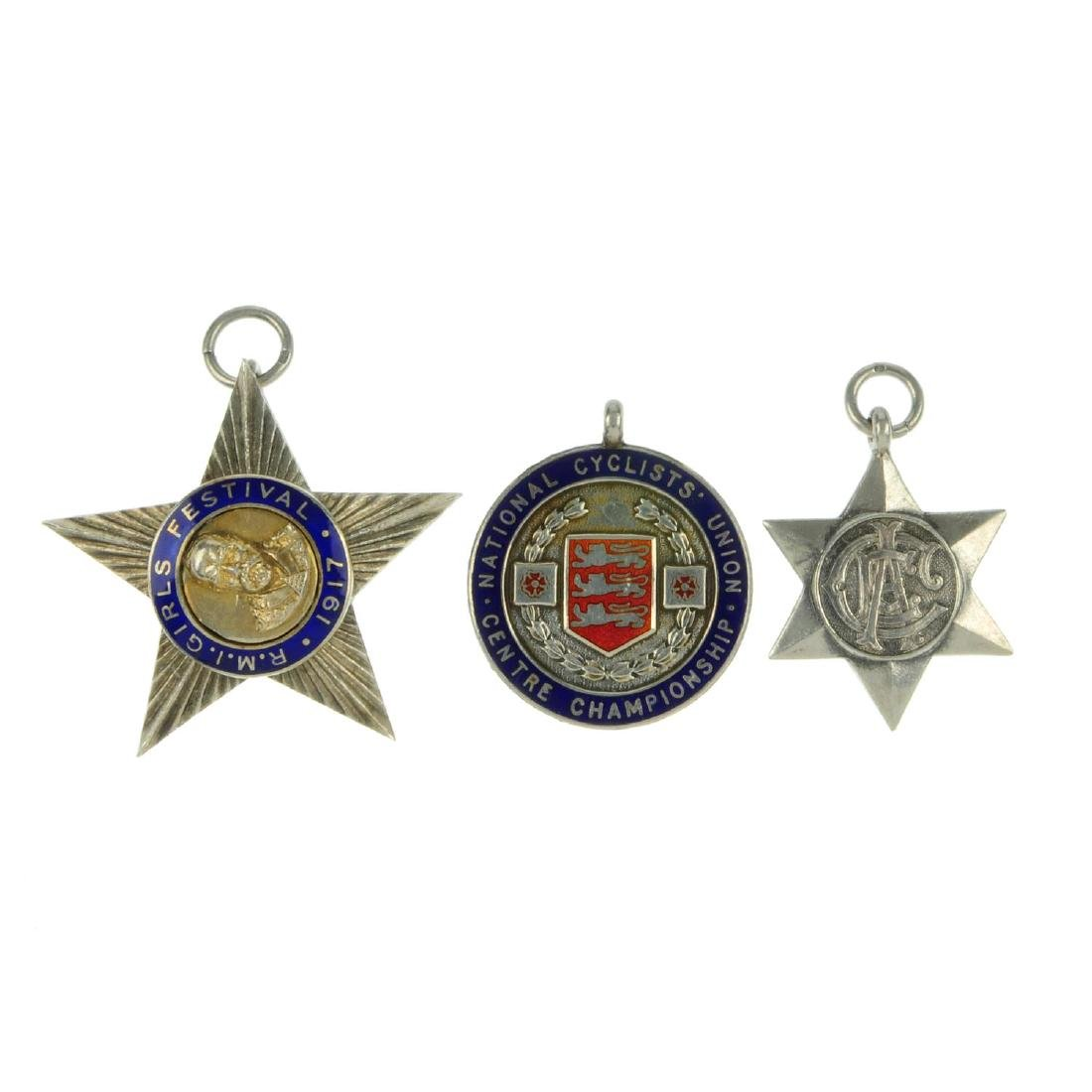 A selection of silver medallions. To include a green