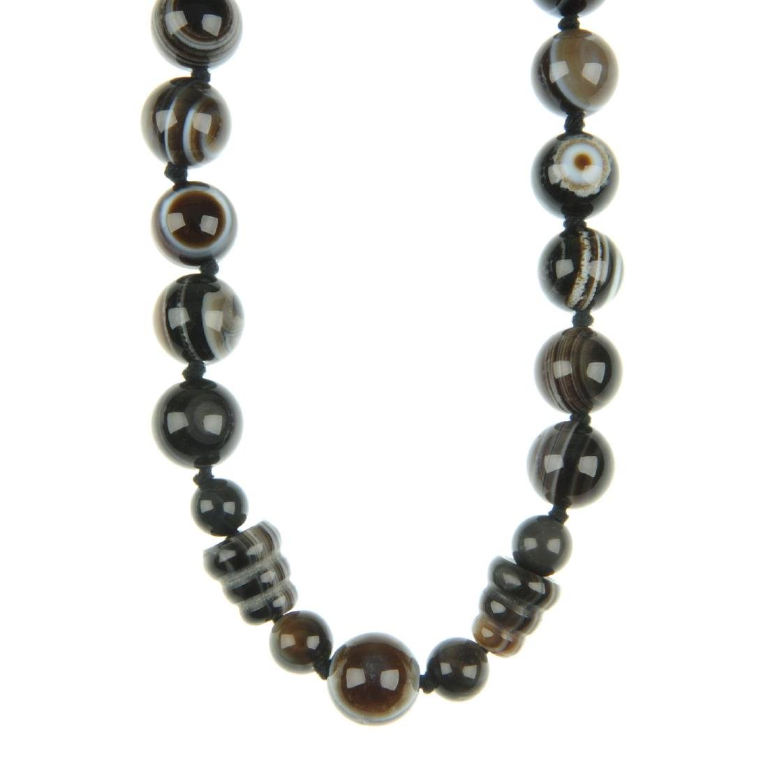 A banded agate bead necklace. The necklace of spherical