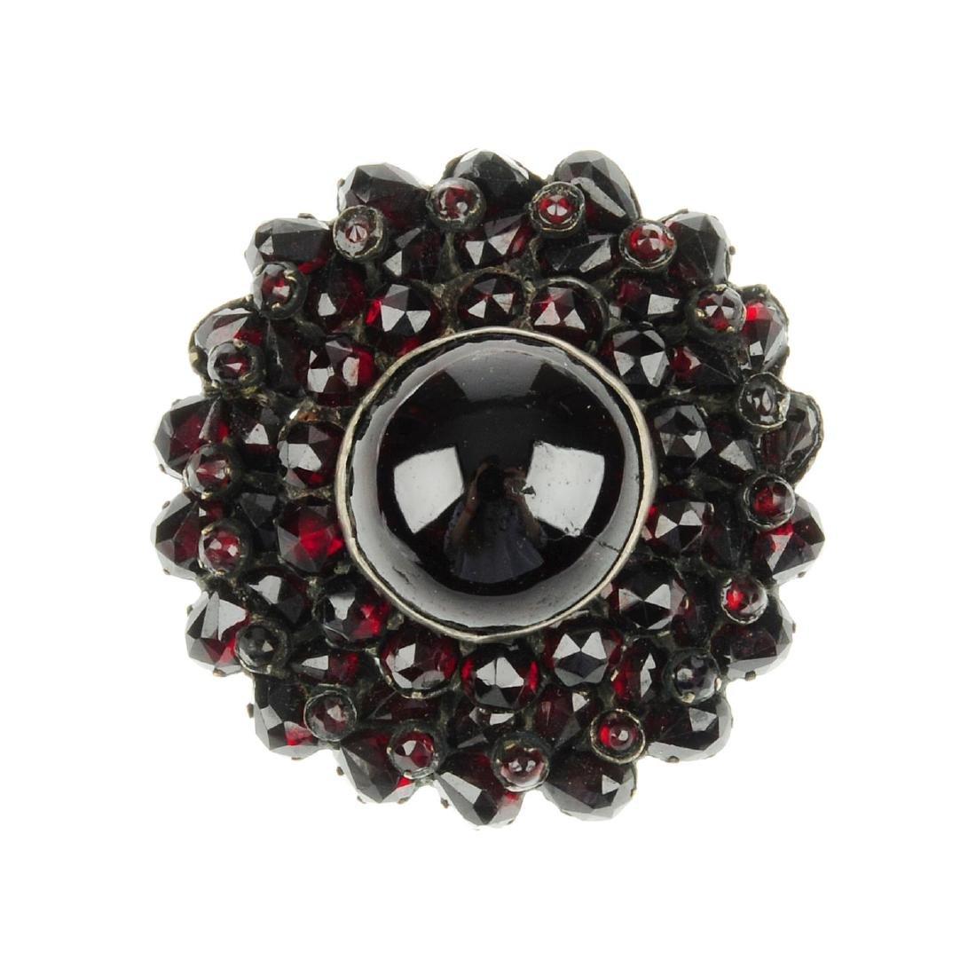 A garnet brooch. Designed as a circular garnet