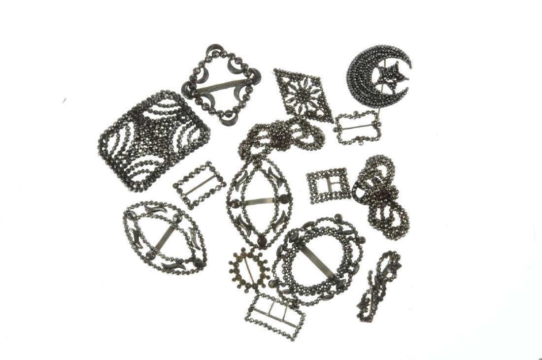 Nineteen cut steel buckles and brooches. To include a - 2