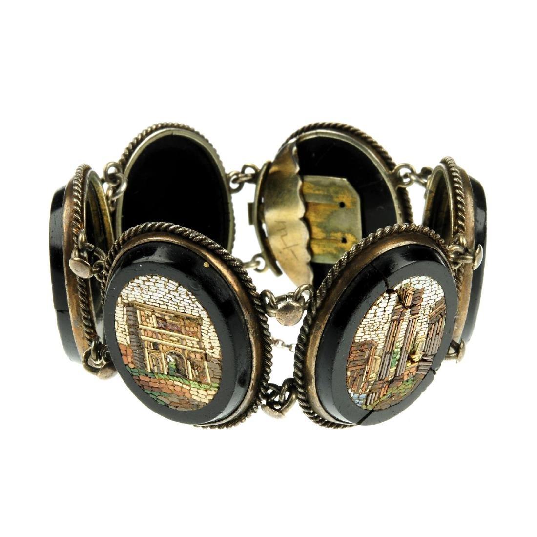 A micro mosaic bracelet. Comprising six oval-shape onyx