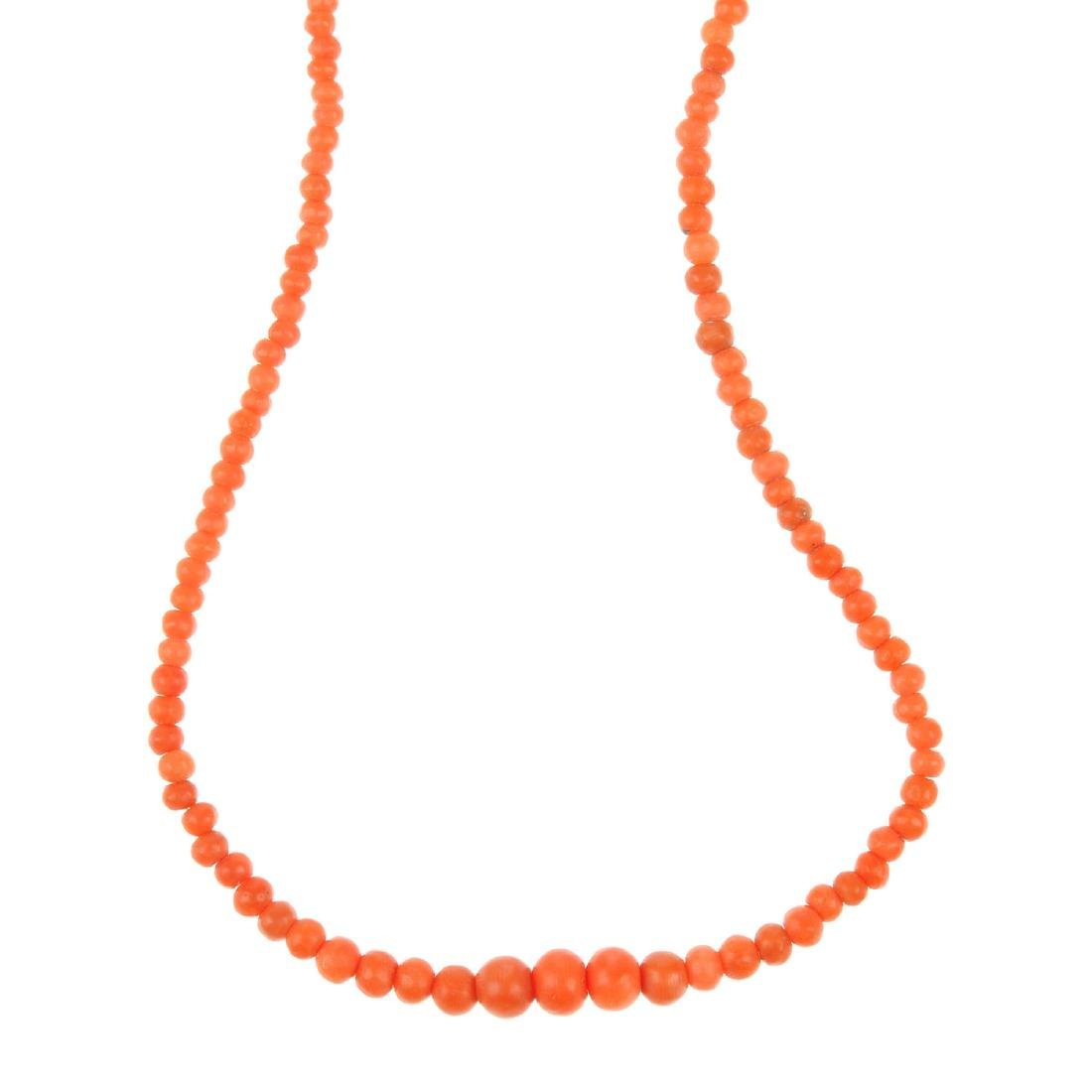 A coral bead necklace. Comprising a single graduated