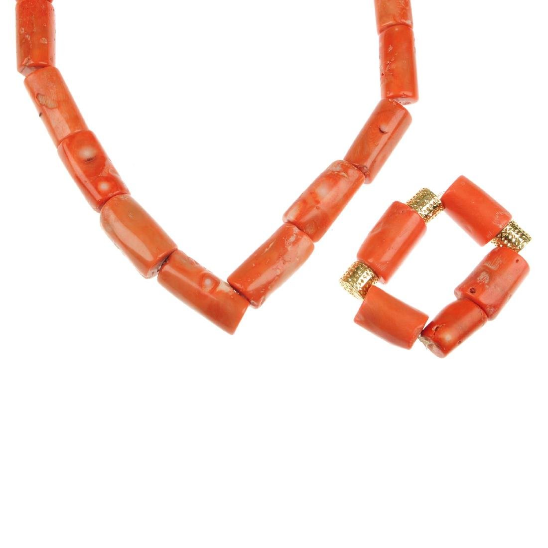 A coral necklace and bracelet. The necklace comprising