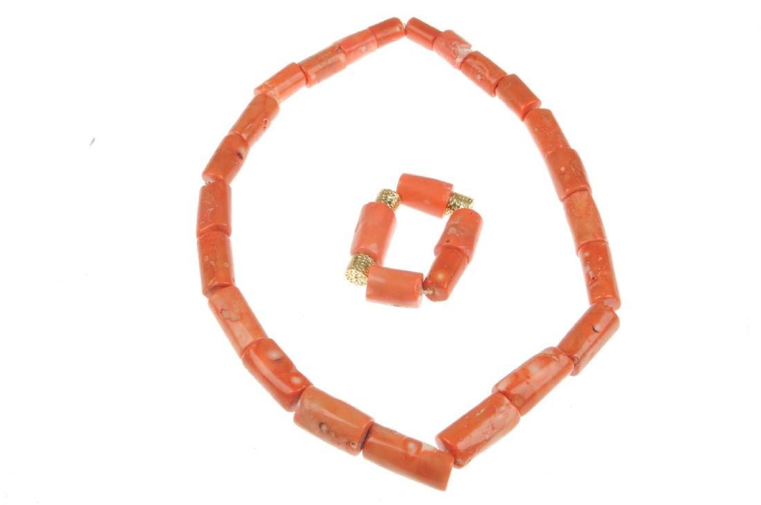 A coral necklace and bracelet. The necklace comprising - 2