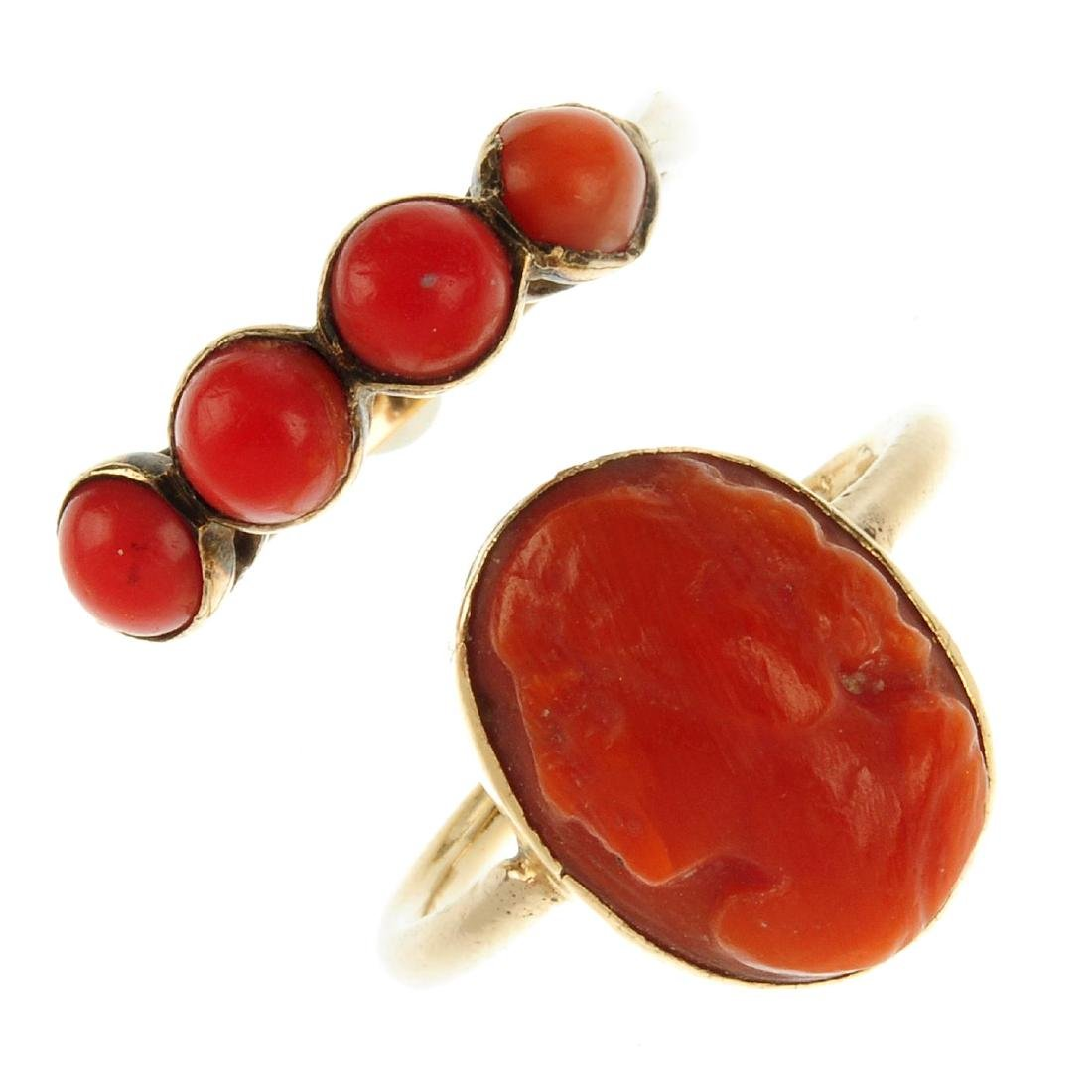 Two coral rings. The first a 9ct gold ring set with