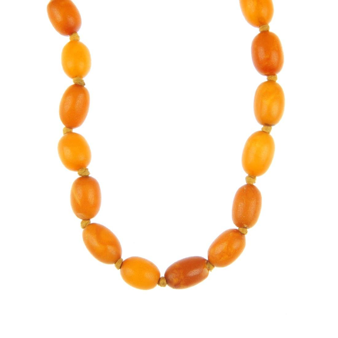 A natural amber bead necklace. The long-length necklace