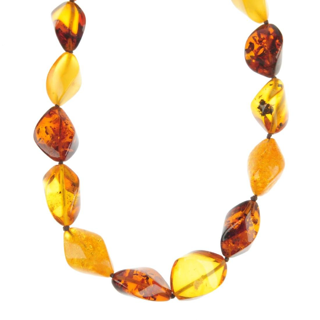 A natural and modified amber necklace. Designed as a
