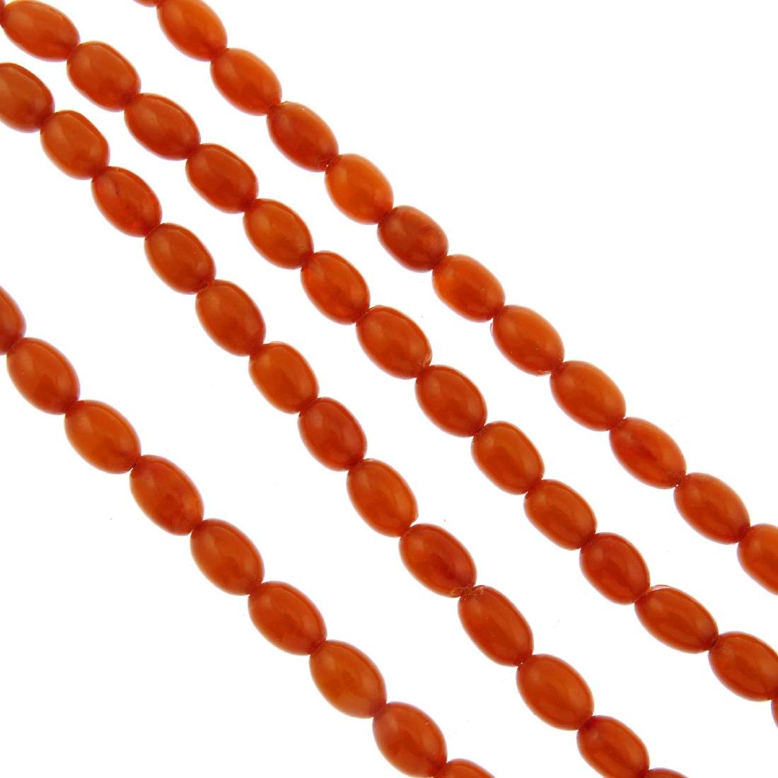 A natural amber bead necklace. Designed as oval beads