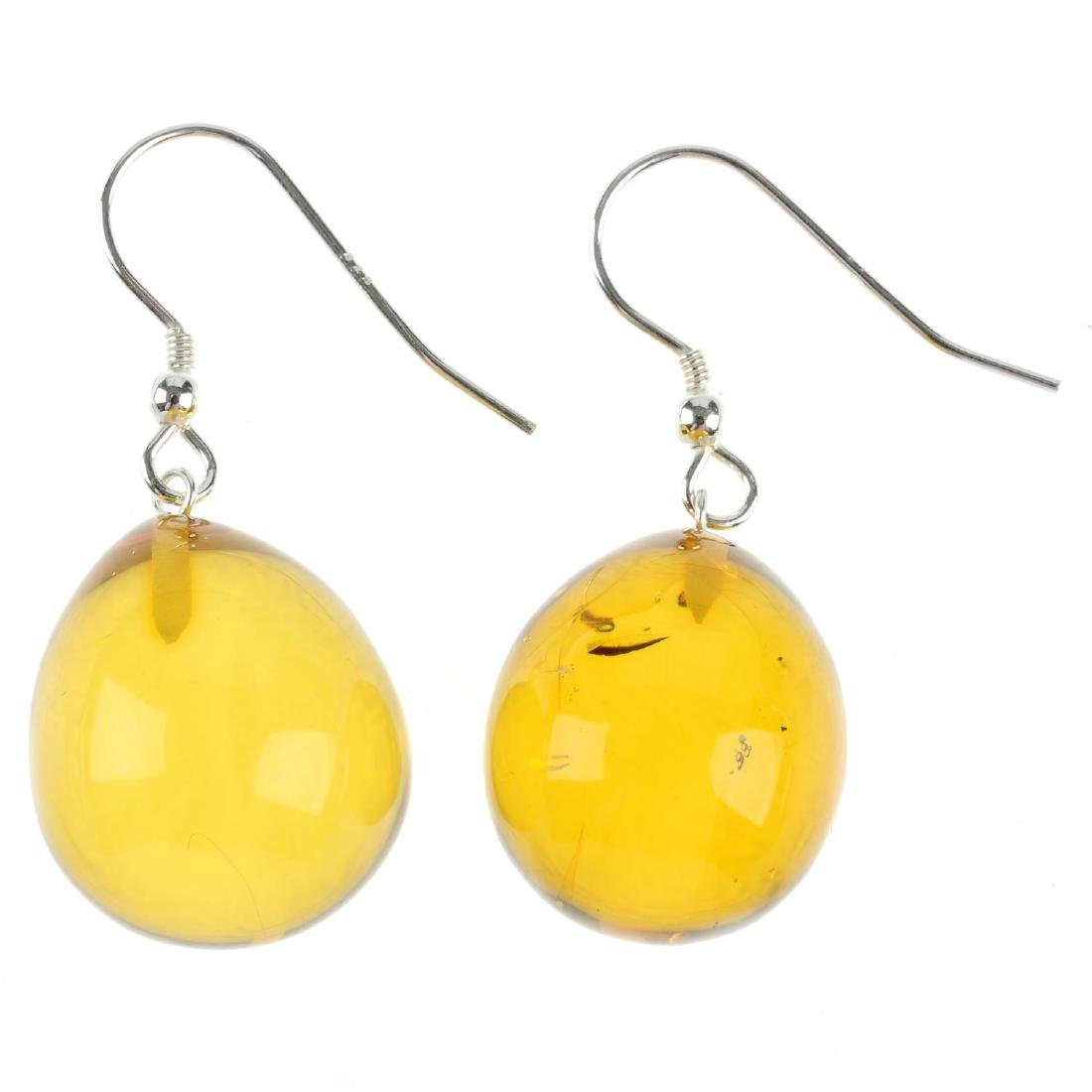 A pair of natural Dominican Republic amber ear pendants