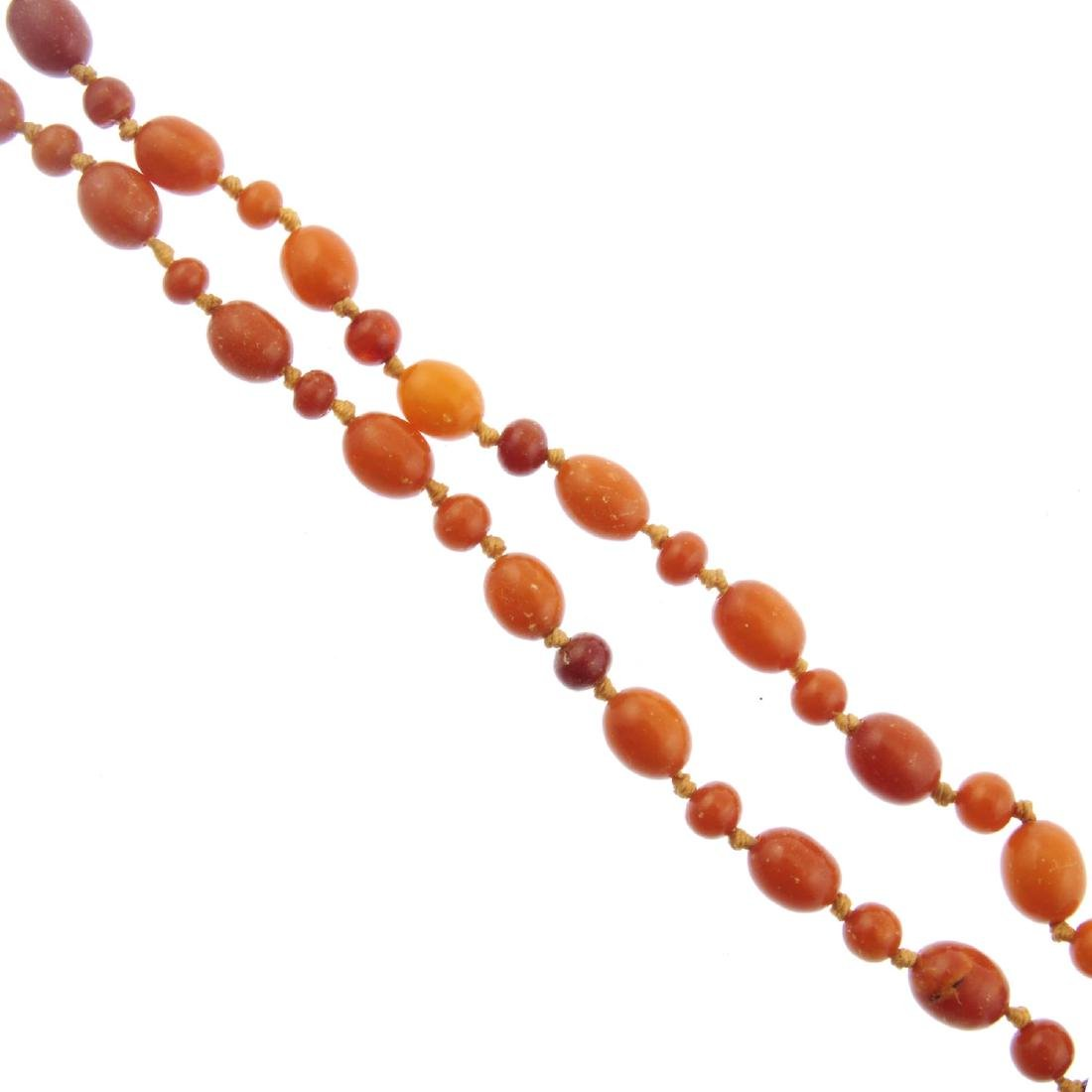 A natural amber bead necklace. Designed as near oval