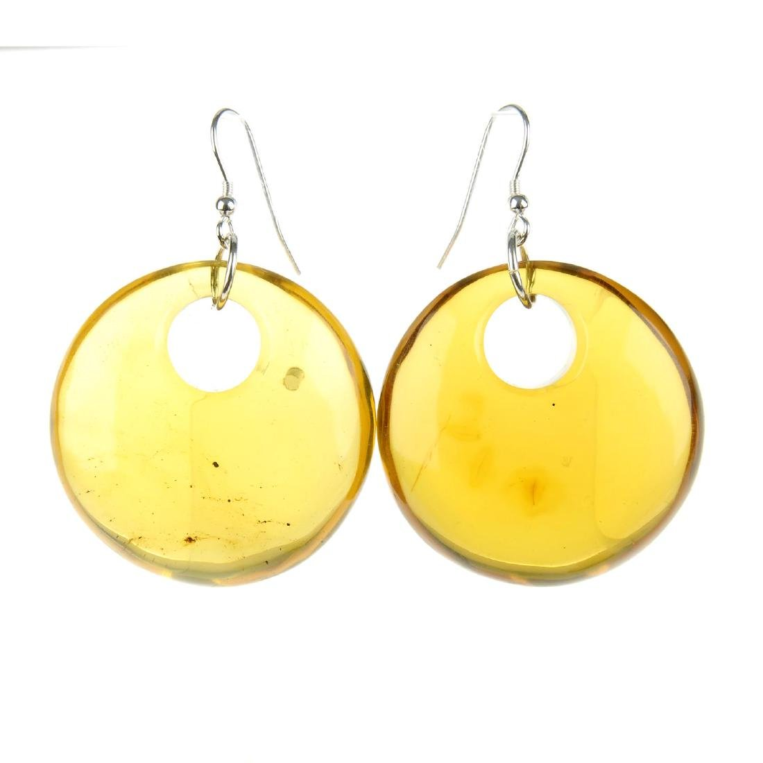 A pair of natural Dominican Republic amber earrings and