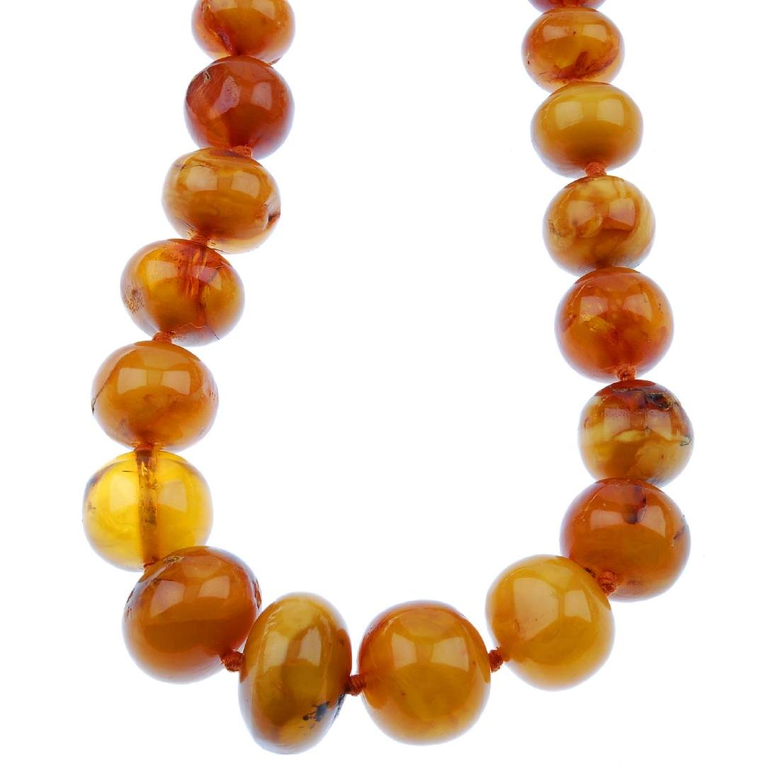 A natural amber bead necklace. Designed as bouton and