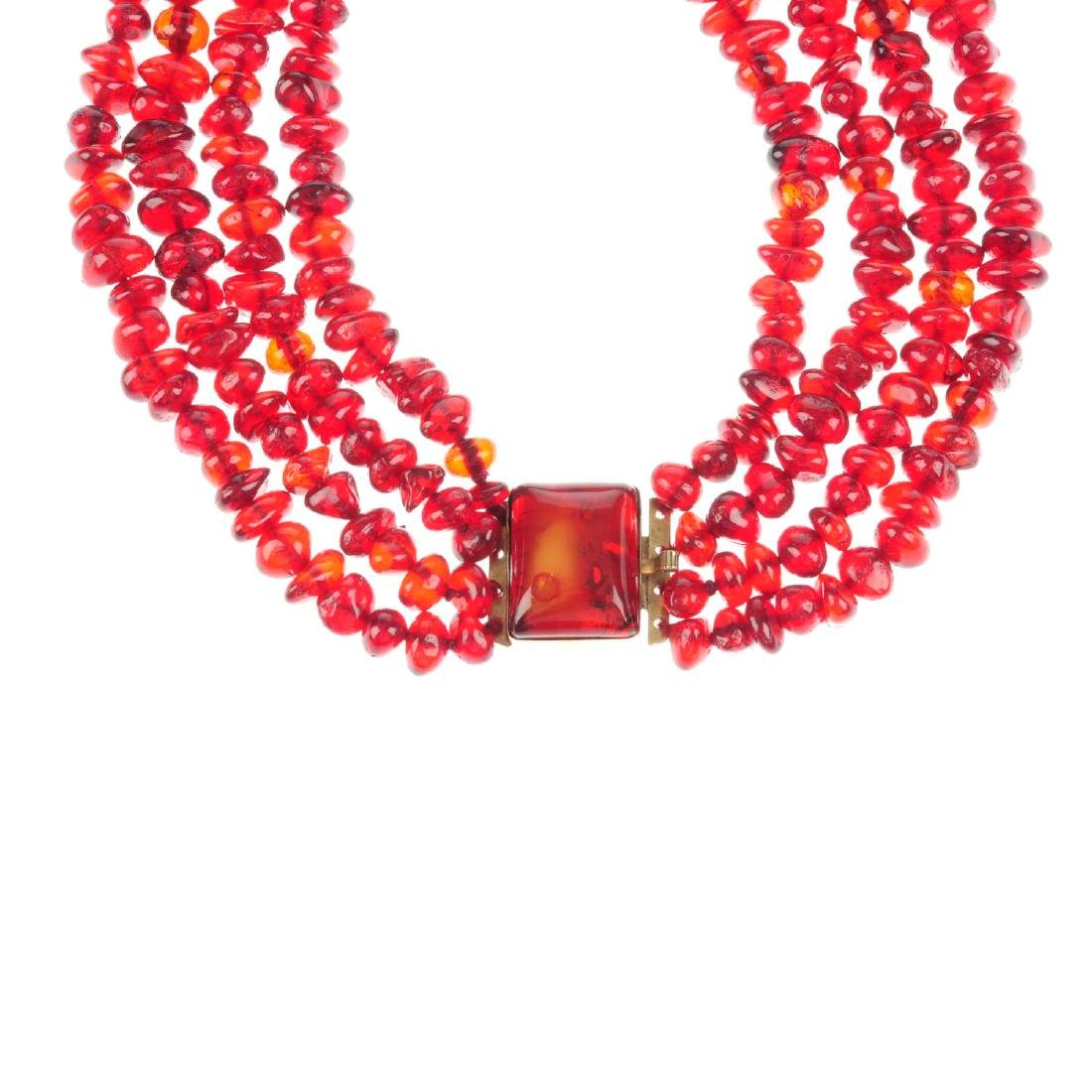 A treated amber choker. Comprising four rows of treated