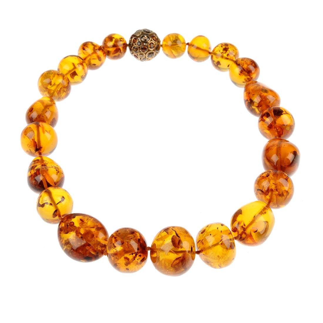 A modified amber bead necklace and a piece of modified