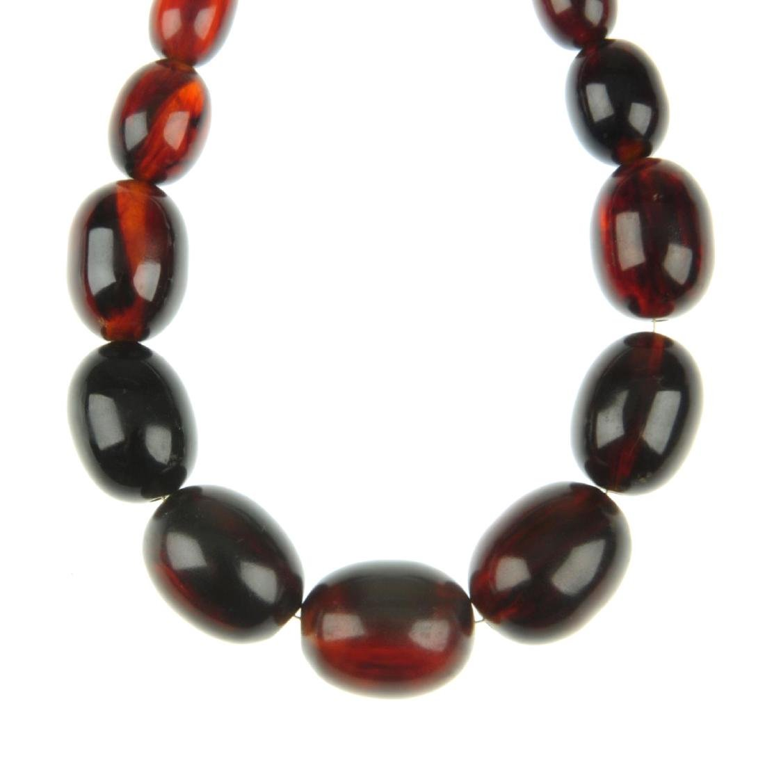 A red plastic bead necklace. Comprising forty