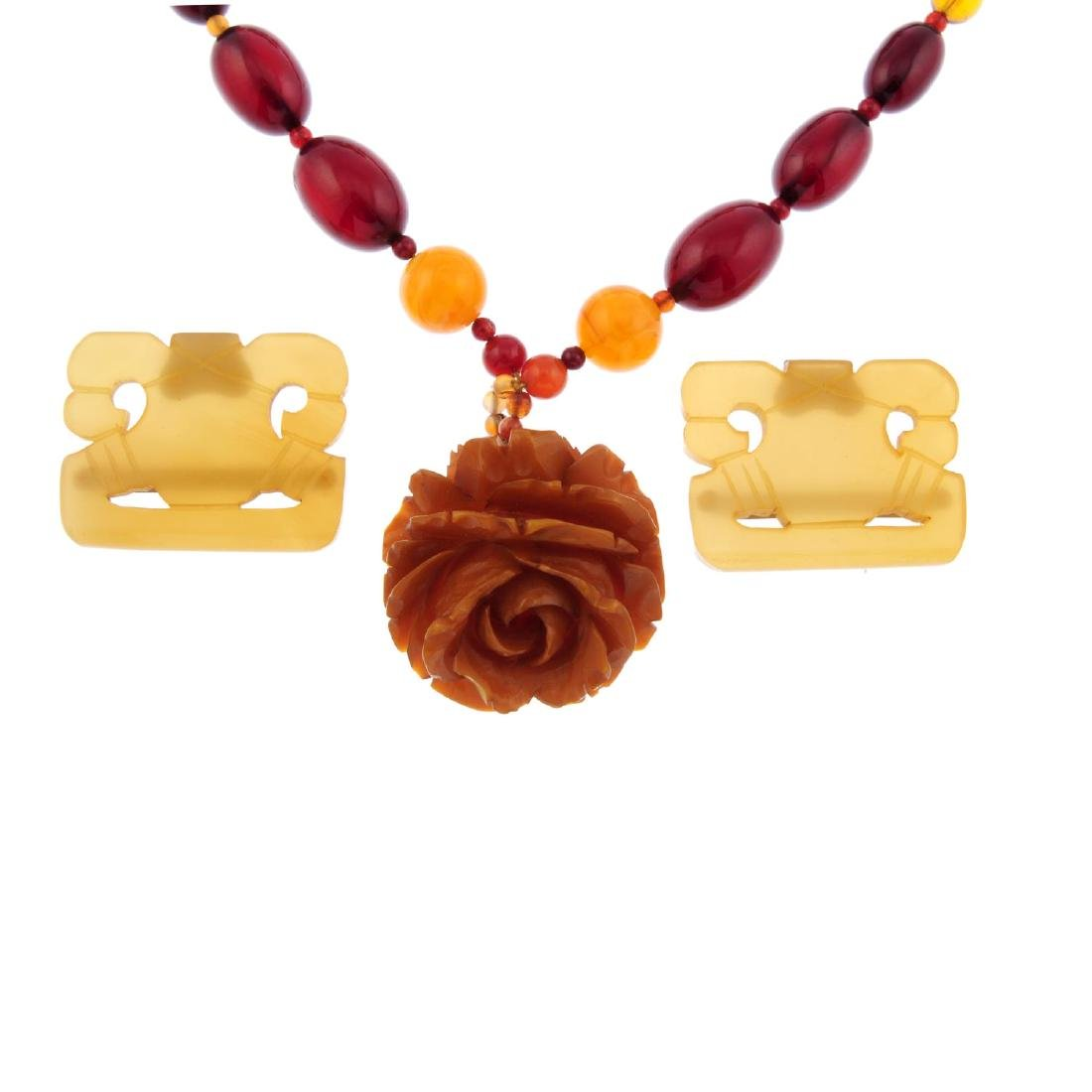 A selection of plastic jewellery. To include a flower