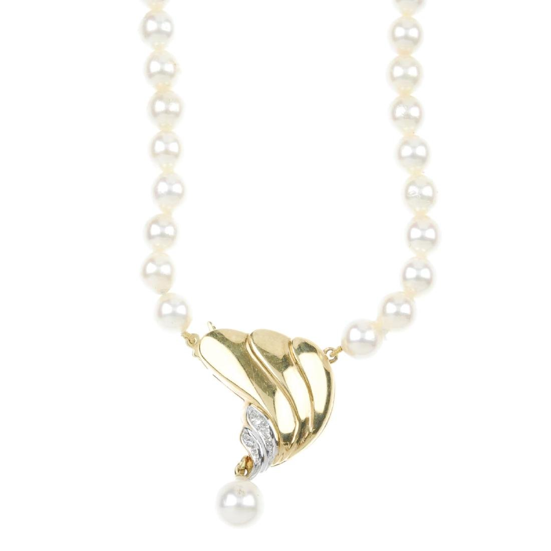 A cultured pearl necklace with diamond-set clasp. The