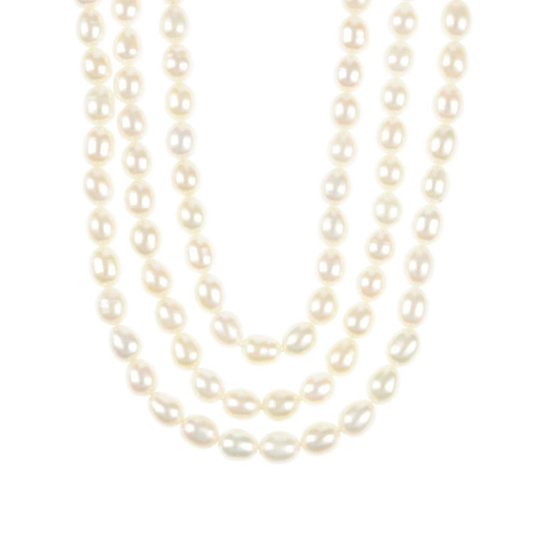 A cultured pearl necklace. Comprising three rows of