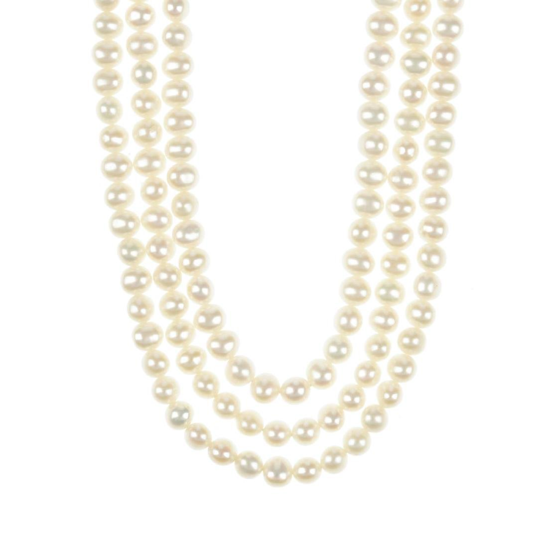 A three-strand cultured pearl necklace. Comprising