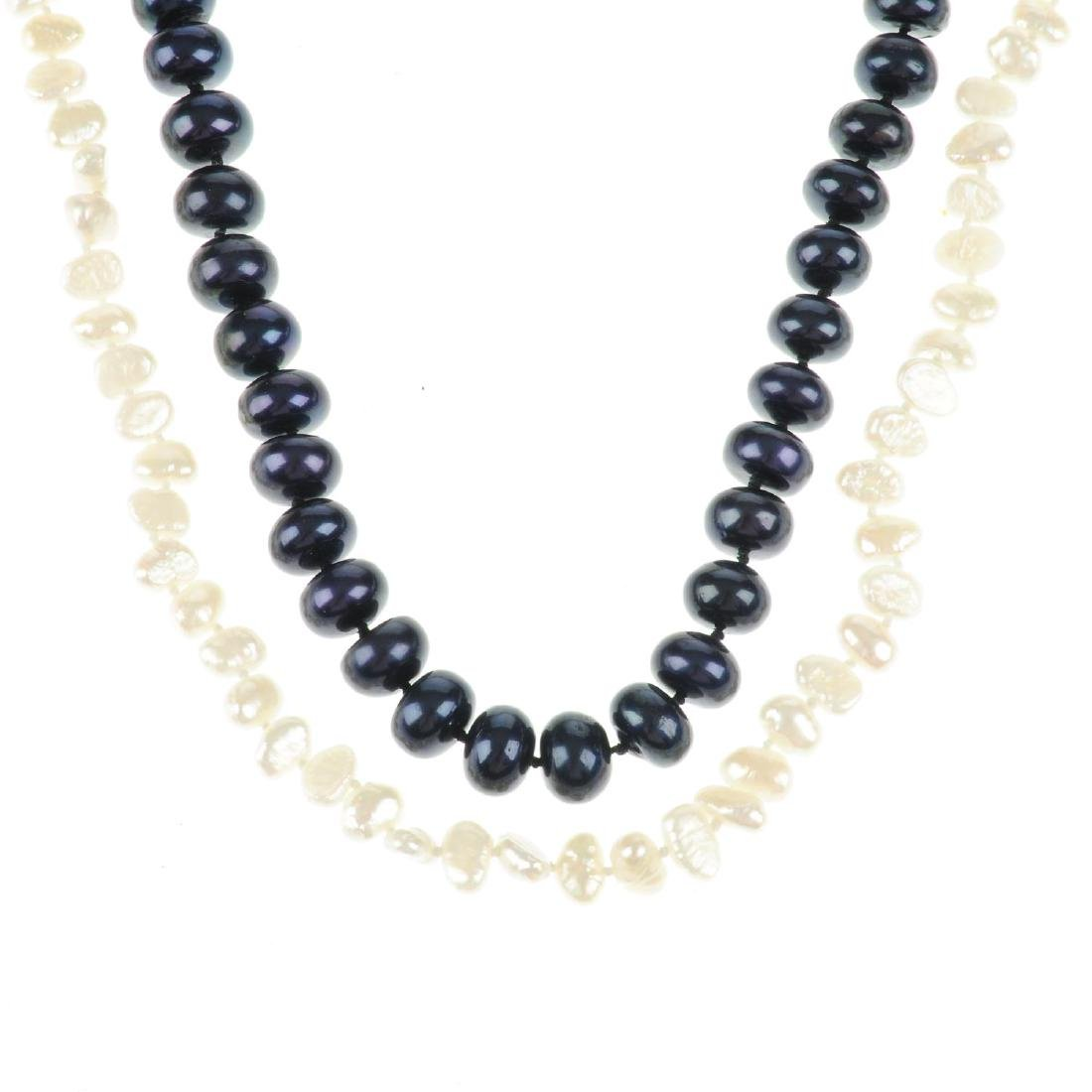 Two freshwater cultured pearl necklaces. The first a
