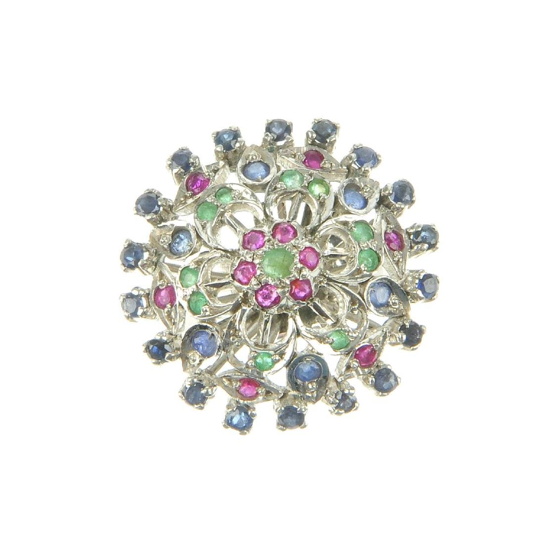 A sapphire, ruby and emerald cluster ring. The circular