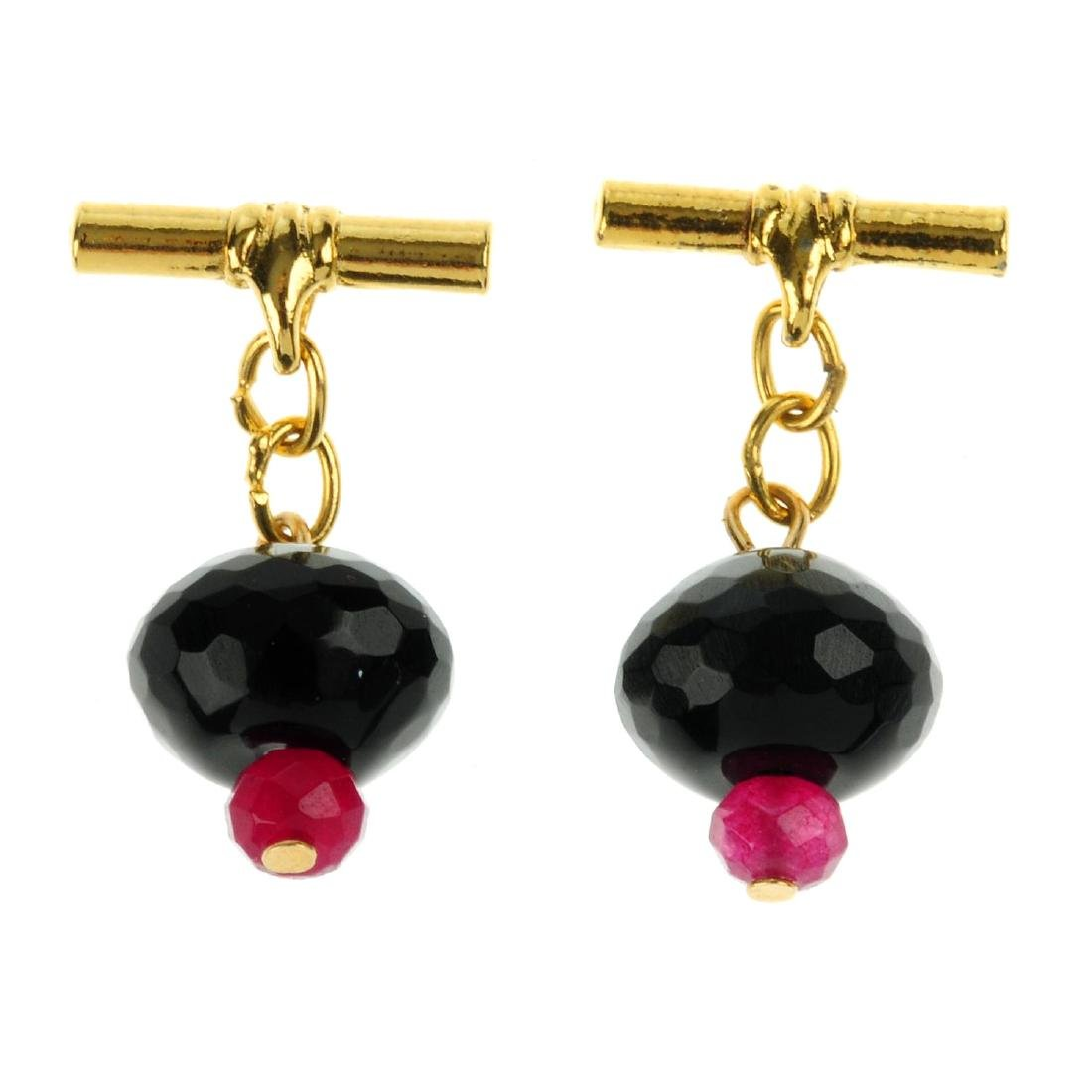 A pair of gem cufflinks. Designed as faceted onyx
