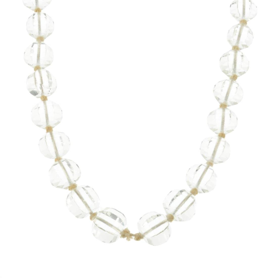 A faceted rock crystal bead necklace. The graduated