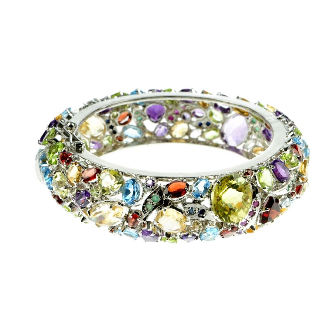 A gem-set bangle. The hinged bangle set with vari-shape