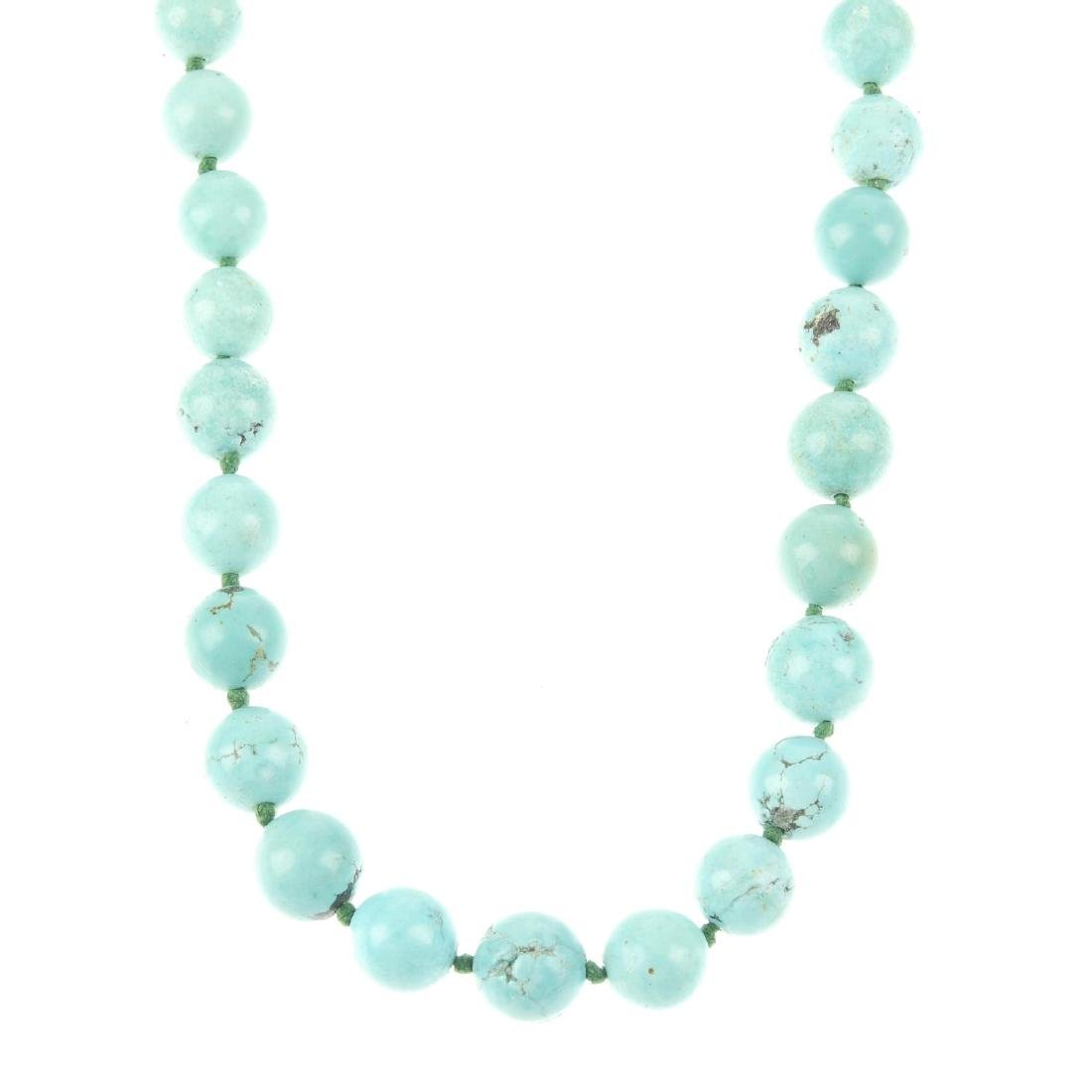 A turquoise necklace. Comprising sixty spherical