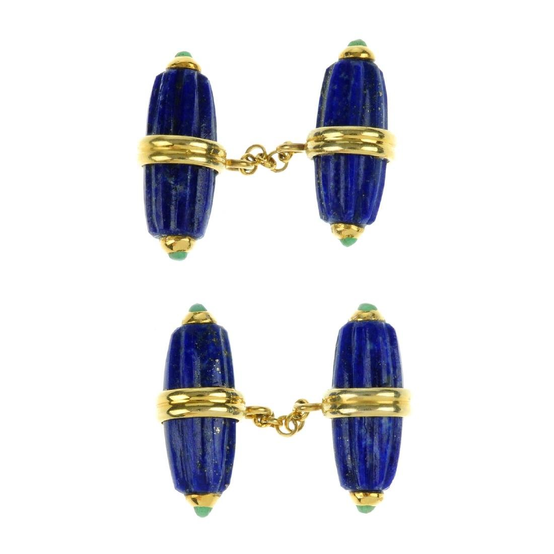 A pair of lapis lazuli and emerald cufflinks. Designed