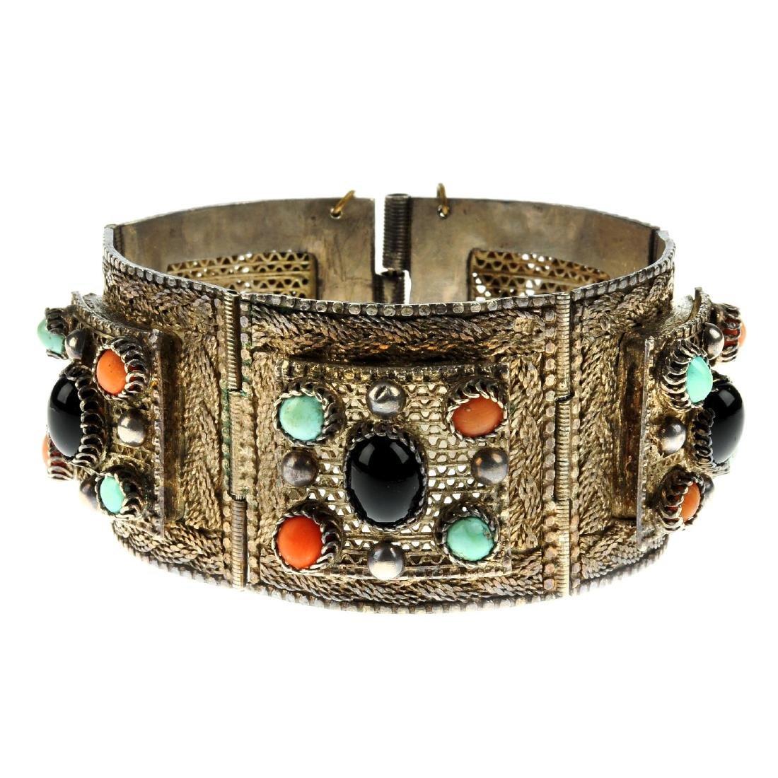 A gem bracelet and necklace. The bracelet comprising