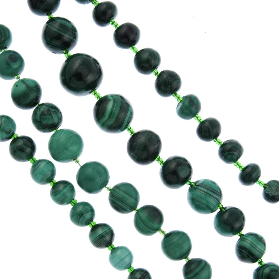 Six malachite necklaces and four garnet necklaces. The