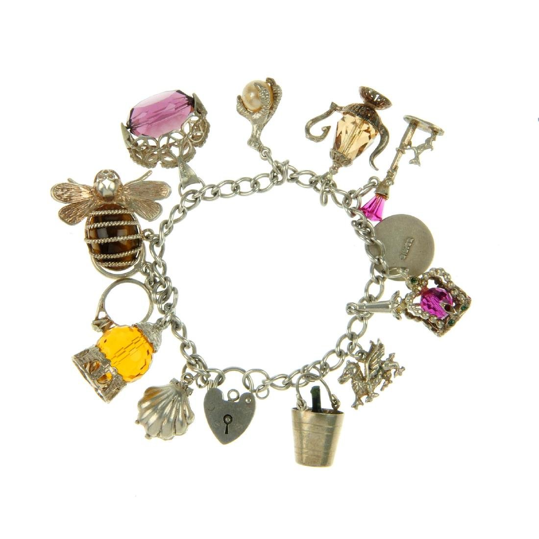 Five charm bracelets. Suspending several charms to