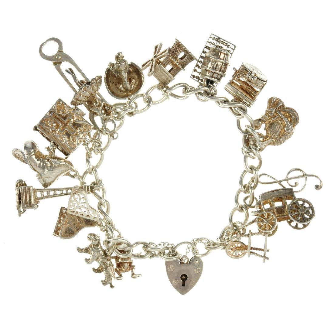 Five charm bracelets. The first a curb-link chain,
