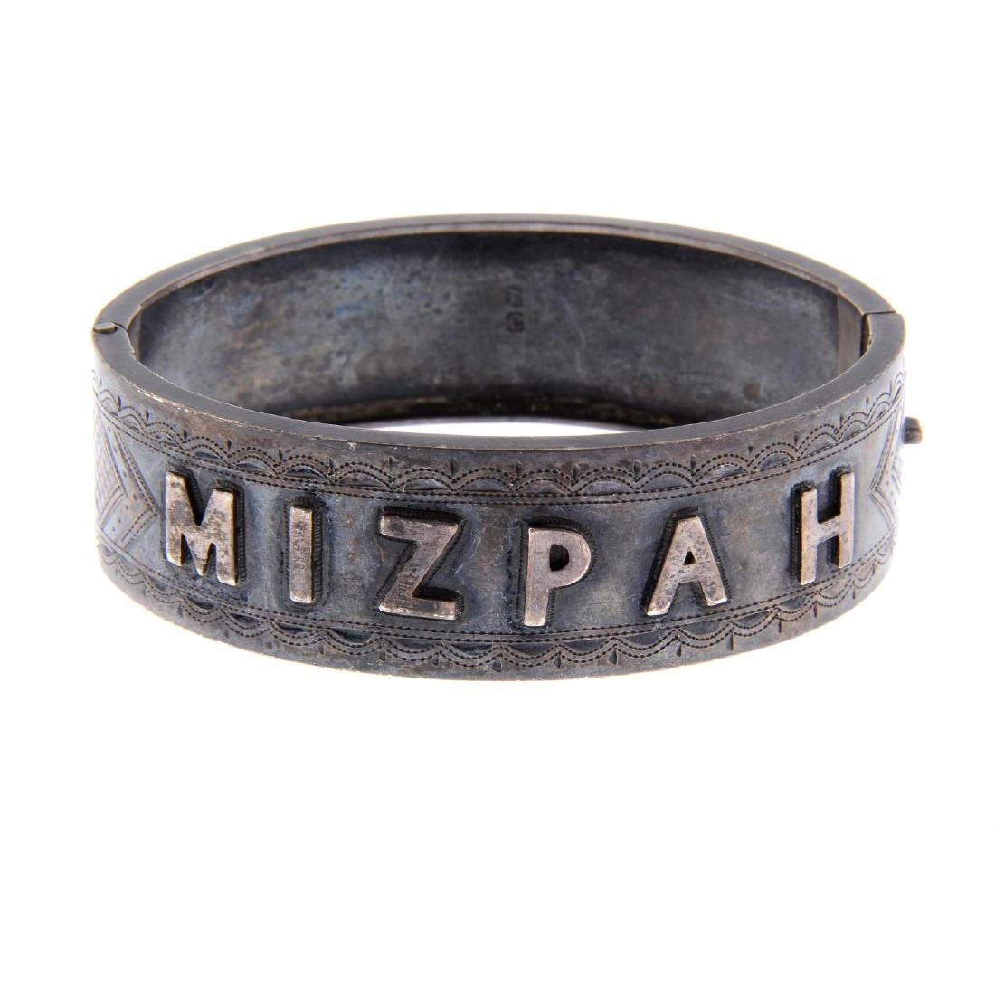 A late Victorian silver hinged bangle. The front bangle