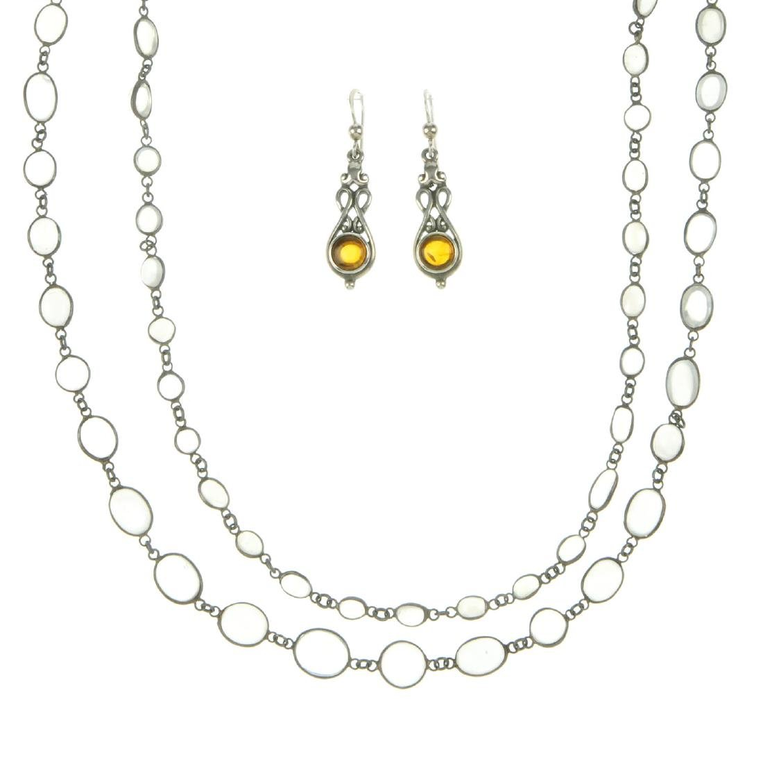 A selection of silver and white metal gem-set