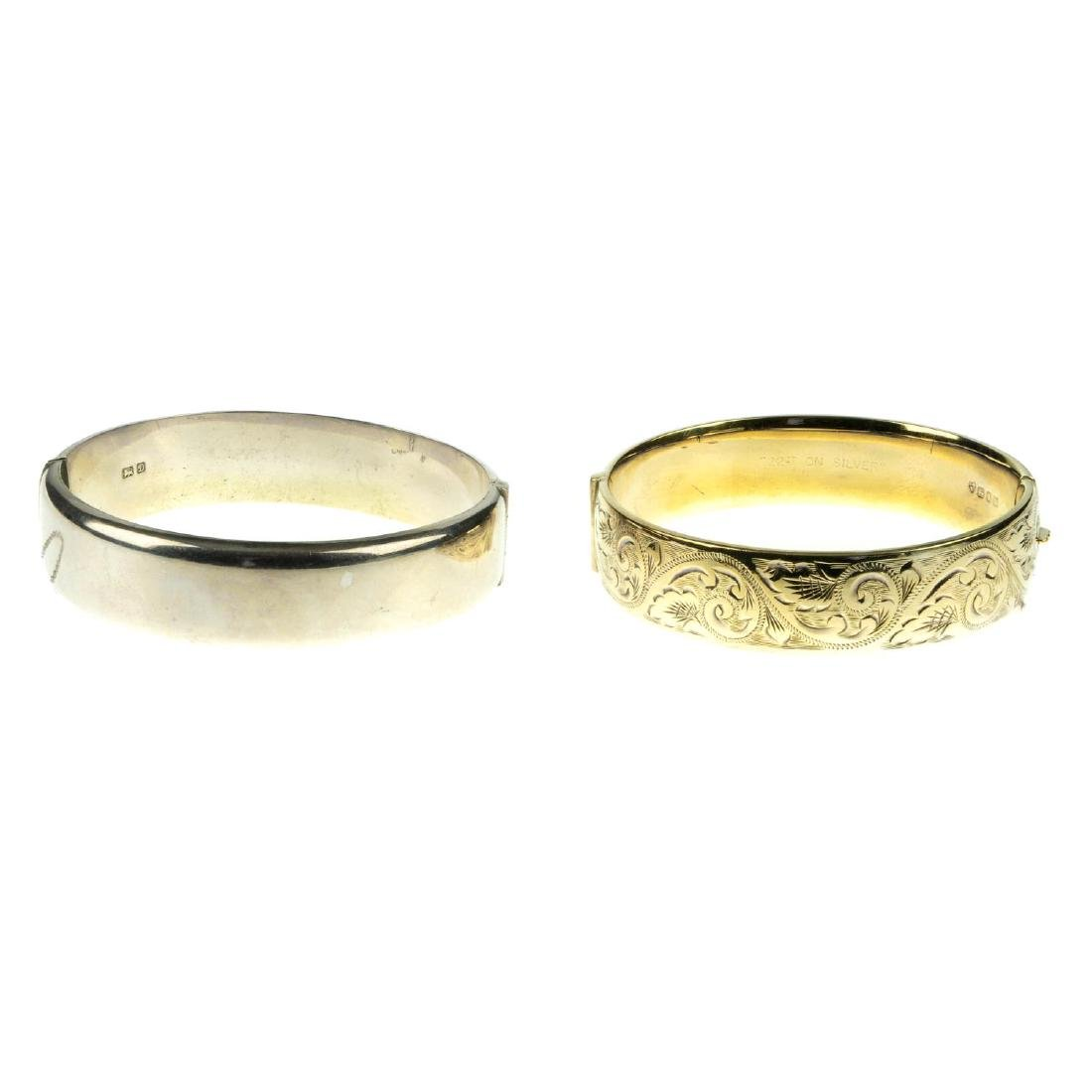Six silver and white metal hinged bangles. To include a