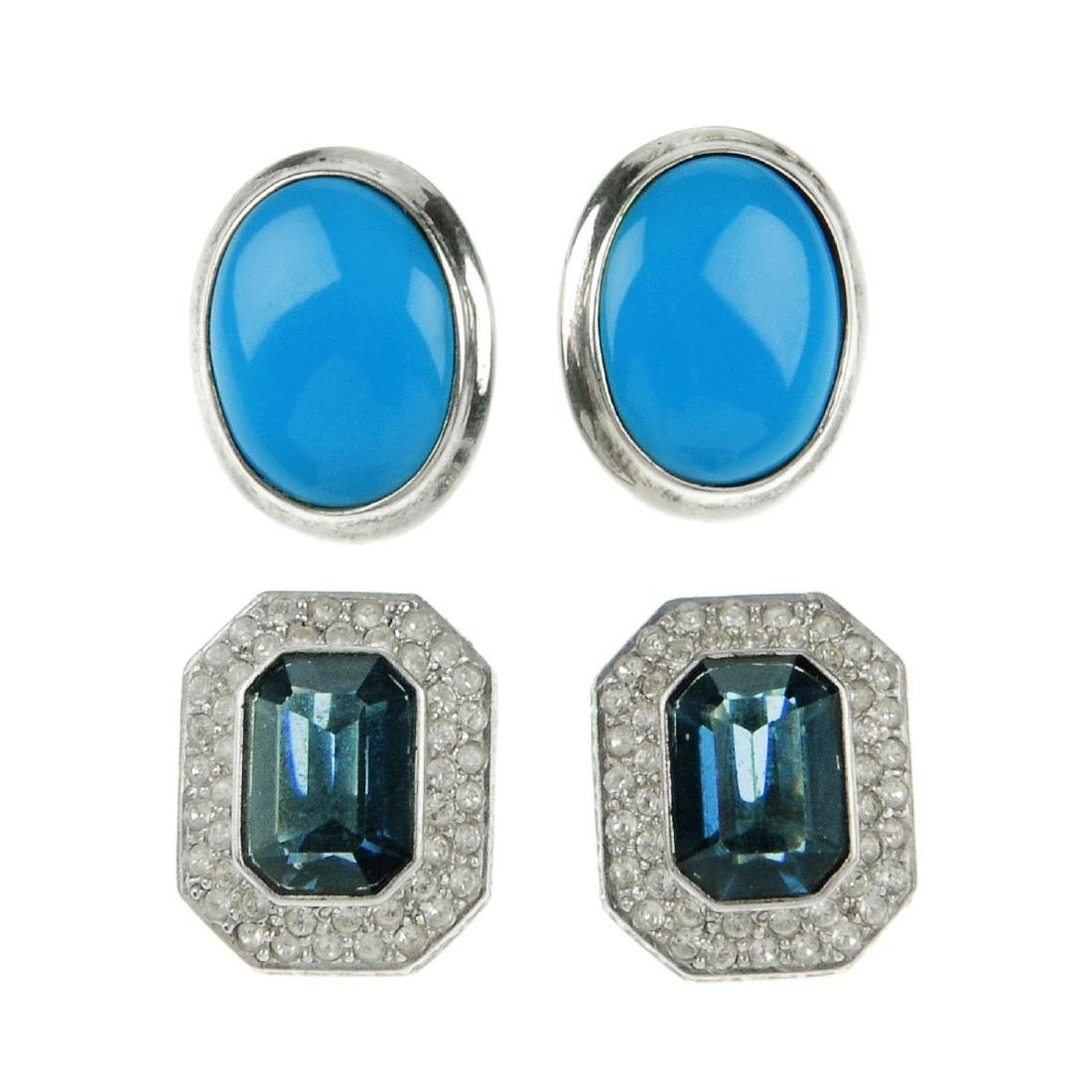 A selection of silver and white metal earrings. To