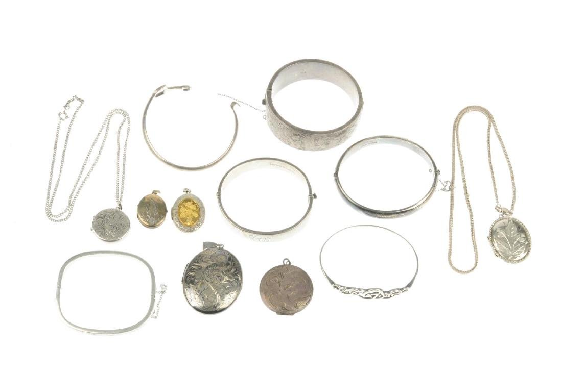 A selection of silver and white metal lockets and - 2